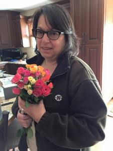 My hardworking and and beautiful mother with the flowers my sister bought her to commemorate her retirement